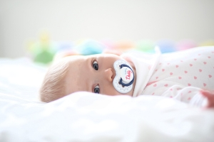 Photo of a baby awake in bed
