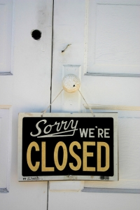 "Photo of a sign reading ""Sorry we're closed"""